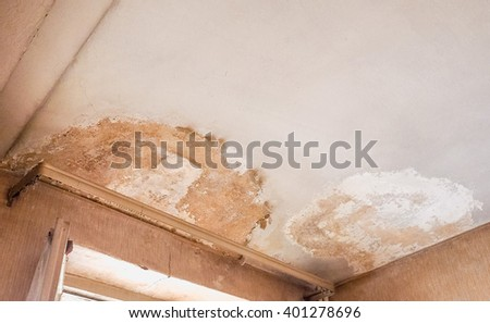 Damage caused by damp and moisture on a ceiling - stock photo