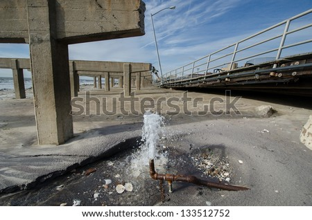 Damage caused by hurricane Sandy to the Rockaway boardwalk, Queens, New York. - stock photo