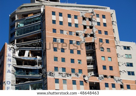 Damage done to a new office building by the 2010 earthquake with 8.8 magnitude in Concepcion city, Chile. - stock photo