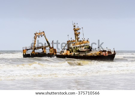 Damaged abandoned ship at the coastline of Namibia