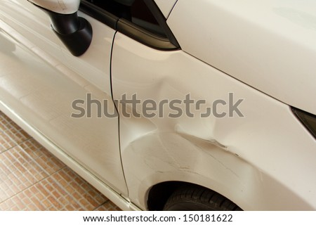 Damaged car after crash accident - stock photo