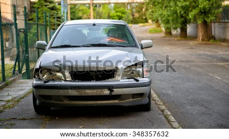 Damaged car after the accident closup photo - stock photo