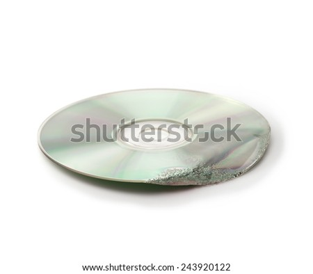 Damaged data. Melted and deformed optical disc (CD, CD-R, DVD, etc ) isolated on white.    - stock photo