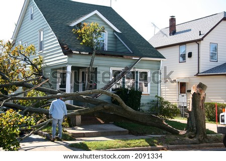 Damaged House from Tree Collapse Due to Storm - stock photo