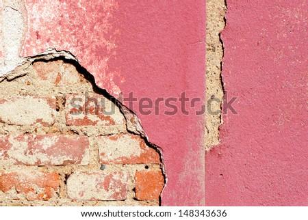 Damaged plaster house. - stock photo