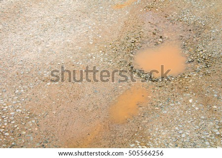 Damaged road with holes, Puddle on asphalt road
