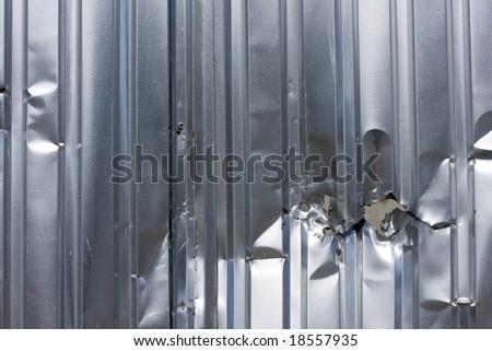 damaged steel fence - stock photo