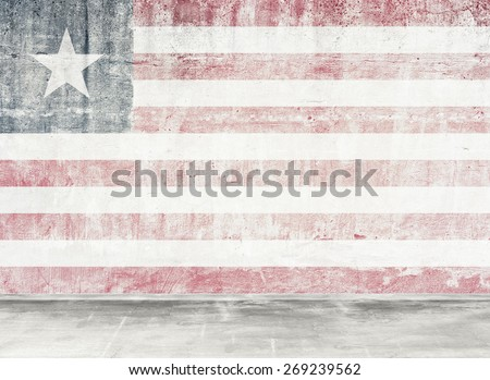 Damaged wall with flag. - stock photo