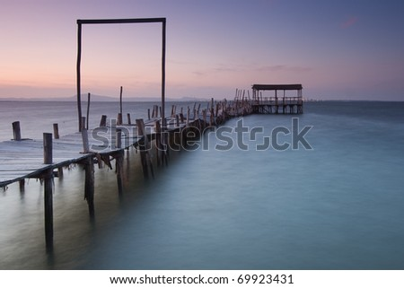 Damaged wood pier at Carrasqueira
