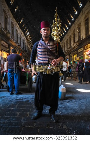 Damascus, Syria, CIRCA September 2013. Man sells cold pomegranate juice on the market in Old Damascus