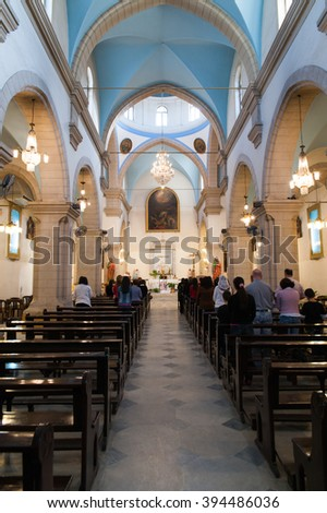DAMASCUS, SYRIA - NOVEMBER 16, 2010: People in Mariamite Cathedral of Damascus.Church is one of oldest Greek Orthodox churches in Damascus Syria and holds the seat of Greek Orthodox Church of Antioch.