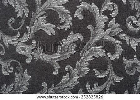 Damask, black fabric pattern texture background - stock photo