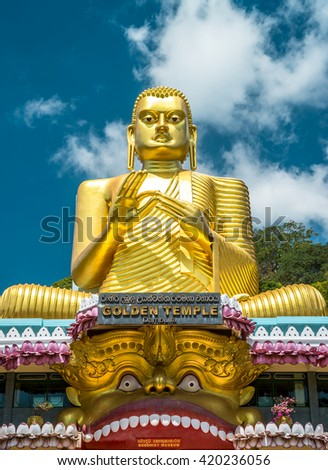 DAMBULLA, SRI LANKA - MARCH 26, 2016: Golden temple in Dambulla the largest cave temple complex in Sri Lanka. Monument declared a World Heritage Site by Unesco.
