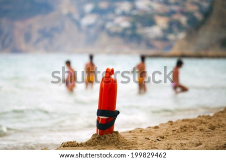 Dan buoy ready to work on the background of people bathing (Calpe, Spain) - stock photo