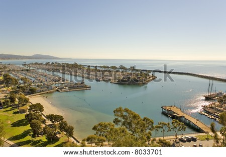 Dana point Harbor and Jetty taken from the hills above. - stock photo