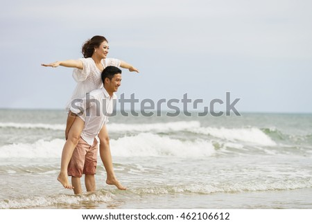 Danang, Vietnam - February 20, 2016: Young couple posing on the China Beach in Danang, in Vietnam
