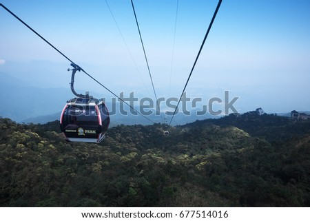 DANANG, VIETNAM - MARCH 4, 2017: Cable Cars through the forest at Ba na Hills, DaNang, Vietnam.