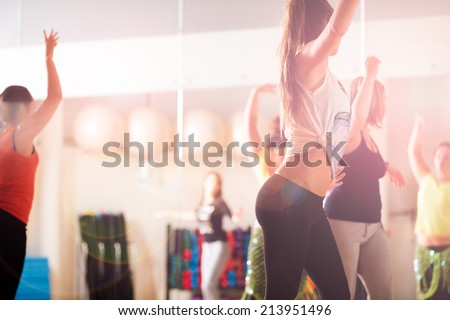 Dance class for women at fitness centre - stock photo