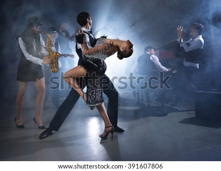 Dance couple dancing ballroom dancing to a live band sounds - stock photo