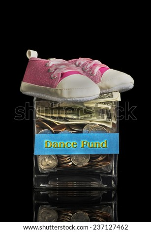 Dance fund jar for your little girl. - stock photo