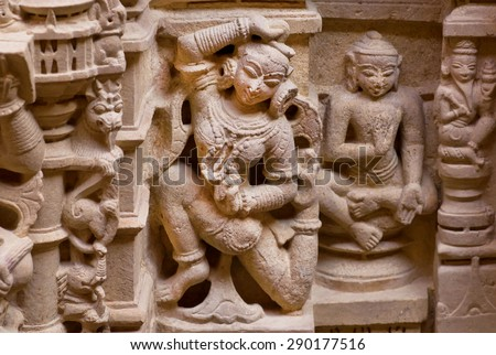 Dance of Indian woman on carved wall of sandstone bas-relief in 12th century Jain temples, Jaisalmer Fort, Rajasthan, India.