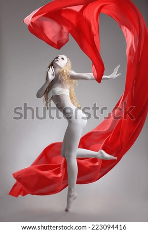 Dance of the beautiful naked nymph with red chiffon cloth - stock photo
