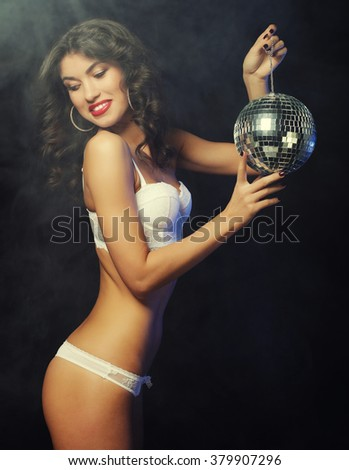 dancer brunette girl in smoke with disco ball - stock photo