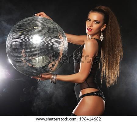 dancer girl in smoke with disco ball, night club  - stock photo