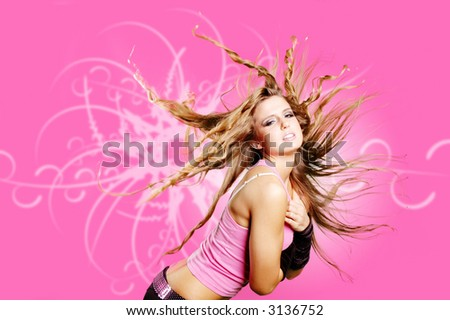dancer girl is doing a hair flip against funky background - stock photo