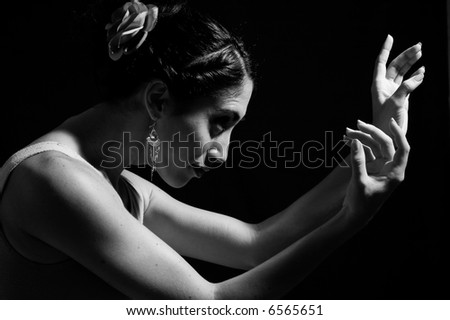 Dancer hands - Artistic portrait of young dancer woman in black and white - stock photo