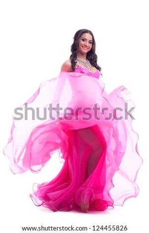 Dancer in east costume performing oriental dance - stock photo