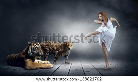 Dancer in posing and tygr - stock photo