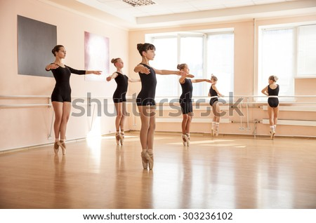 Dancer is doing exercises in ballet class - stock photo
