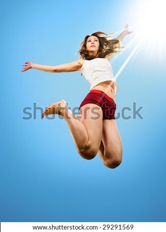 dancer jumping behind blue sky