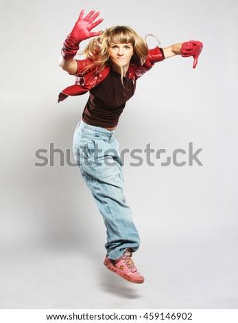 dancer posing on studio background  - stock photo