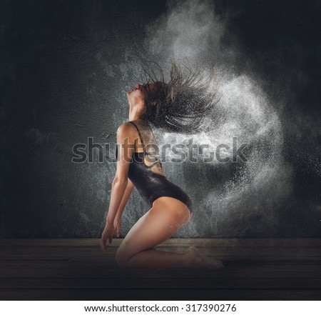 Dancer raises white dust with her hair - stock photo