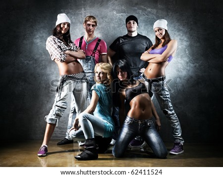 Dancer team. Contrast colors effect. - stock photo