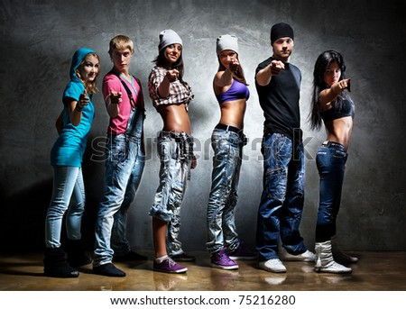 Dancer team pointing. Contrast colors. - stock photo