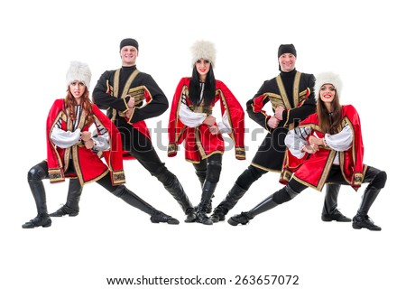 Dancer team wearing a folk Caucasian highlander costumes dancing.  Isolated on white background in full length. - stock photo