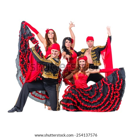 dancer team wearing in traditional flamenco dresses, isolated on white background in full length. - stock photo