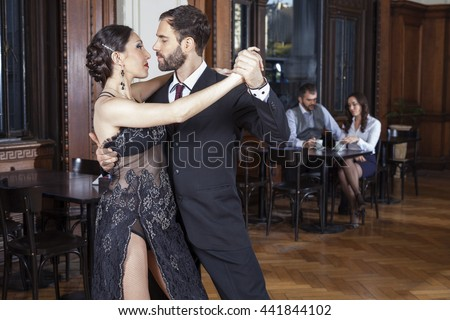 Dancers Doing Tango While Mid Adult Couple Dating
