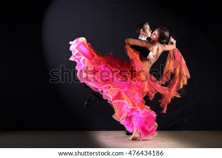 dancers in ballroom isolated on black
