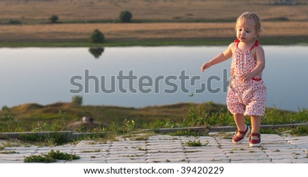 Dancing baby-girl outdoor