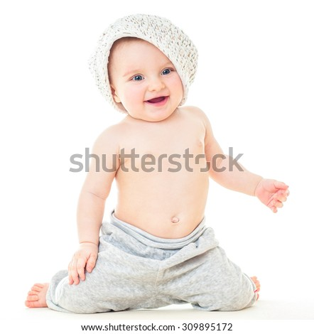 Dancing baby. ?heerful baby in the hat. Beautiful happy baby . One,isolated on white. Laughing baby. - stock photo