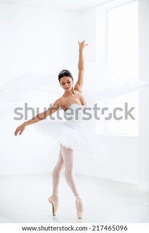 Dancing ballerina in the studio - stock photo