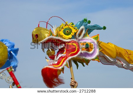 dancing dragon at a new year celebration - stock photo