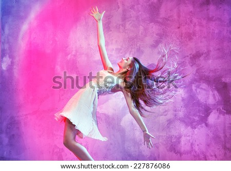 Dancing girl on colorful background - stock photo
