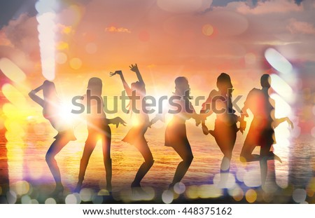 Dancing girls silhouettes against of sunset at the beach - stock photo