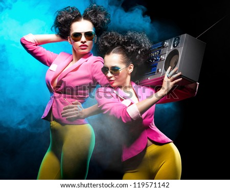 Dancing girls with a tape recorder - stock photo