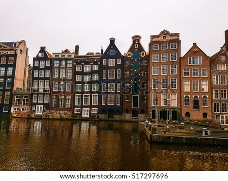 dancing historical canal house at Amsterdam Netherlands ,Colorful row of canal houses in vintage toning  in the grachtengordeal the UNESCO World Heritage site of Amsterdam